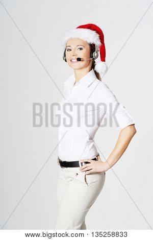 Call center woman with red Christmas hat