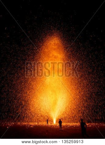 silhouette people in firework streaks for background
