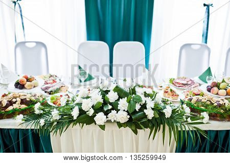 Wedding table of newlyweds with flowers at wedding