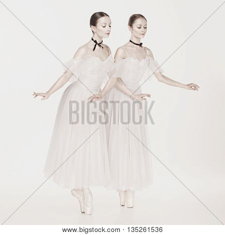 Romantic Beauty. The portrait of a two woman as ballerinas in retro style