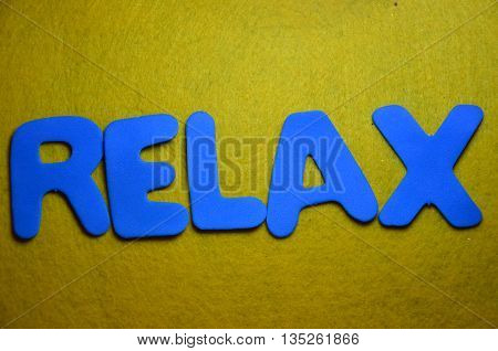 word relax on a  abstract yellow background