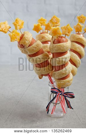 Stripes and stars decorated sausages for 4th july