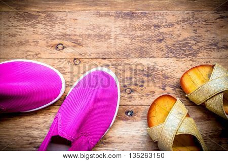 Mother and Daughter pink shoes on wooden background Mothers Day.