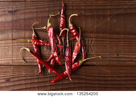 Dried Chili Still Life. Horizontal format on a rustic wood table with copy space.