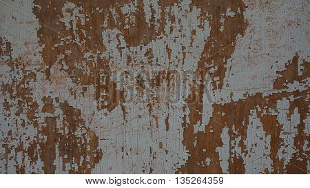 paint on a wooden fence like rust on metal