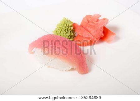 Tuna nigiri sushi with ginger and vasabi