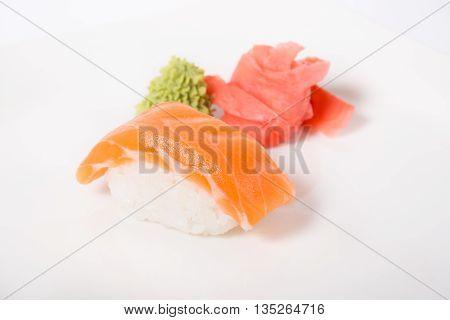 Japanese nigiri sushi with raw salmon and ginger