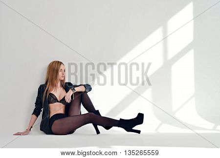 Beautiful Sexy Lady In Elegant Tights And Bra Isolated On A White Background. Fashion Portrait Of Mo