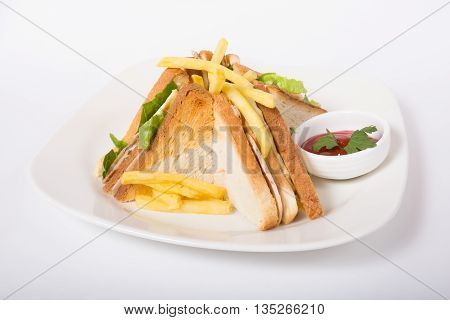Sandwich with french fries and ketchup sauce