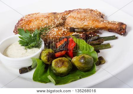 Fried half of chicken with grilled green vegetables