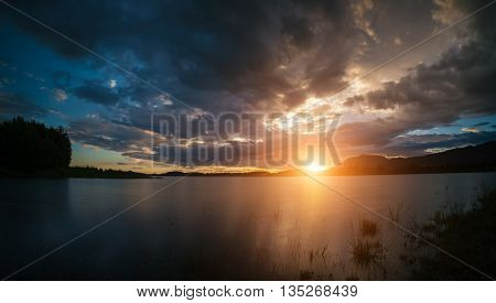 colorful of a Summer sunset at a new Hampshire lake,USA, America