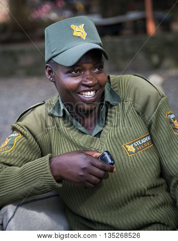 AFRICA, KENYA, MAY, 05, 2016 - Smiling african female guard in a uniform at the Giraffe Centre in Nairobi, Kenya