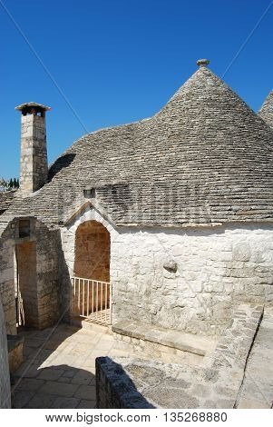 An alley between the trulli of Alberobello in Apulia - Italy