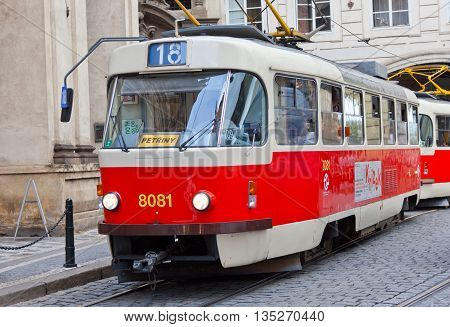 PRAGUE CZECH REPUBLIC - JULY 30,2013:Czech tram in historical center of Prague. Annually Prague is visited by more than 35 million tourists.