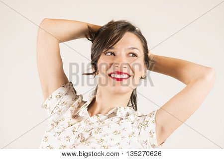 Expressive portrait of a beautiful brunette girl in studio on white background
