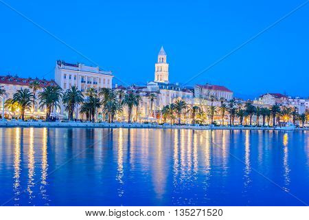 Waterfront view at coastline panorama of town of Split in blue hour, Croatia.