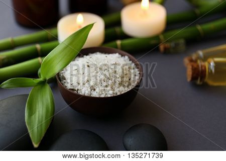 Beautiful composition of spa treatment on grey background