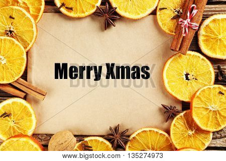 Dried orange slices on a brown wooden table, Merry xmas
