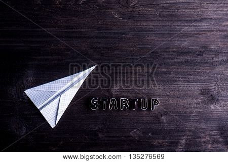 Office Desk With Start Up Sign And Paper Plane.