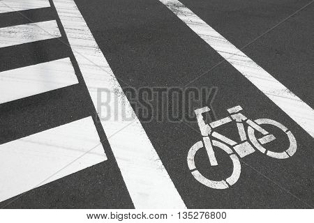 White Zebra Crossing And Bicycle On Car Road