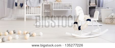 White cozy baby room with sailor design