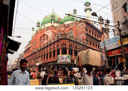 KOLKATA, INDIA - JAN 13, 2016: Traffic on the street near the Nakhoda Masjid mosque on January 13, 2016 in Kolkata. The total cost incurred for the Mosque construction was 1,500,000 Indian rupees in 1926.