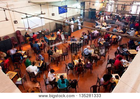 KOLKATA, INDIA - JAN 18, 2016: Visitors of popular Indian Coffee House have lunch on January 18, 2016 in Kolkata India. The India Coffee House chain was started by the Coffee Cess Committee in 1936 in Bombay