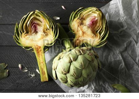 Artichokes on wooden background