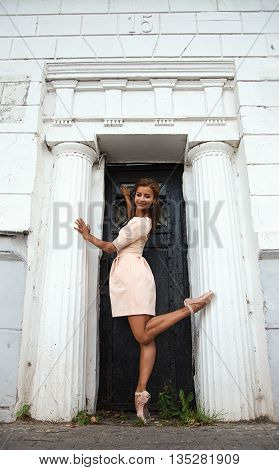 Ballerina at the entrance of the old mansion