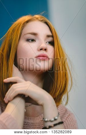 Red-haired Girl Sits In A Cafe