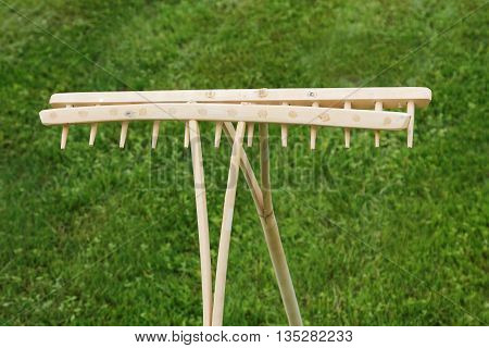 Retro Wooden Rake Handmade  on grass background