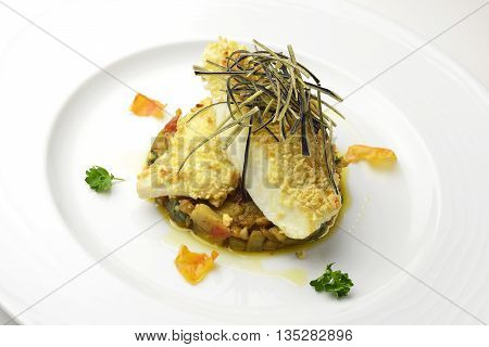 Fish dish fillet of turbot in almond crust on chopped eggplant and stewed with eggplant chips