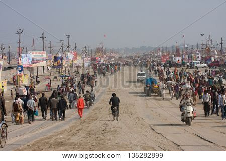 SANGAM, INDIA - JAN 27, 2013: Many people go through the giant camp area during the biggest festival in the world - Kumbh Mela on January 27, 2013 in Allahabad. Mela 2013 had take 130 000000 visitors