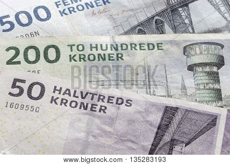 Closeup of stack of danish bank notes 50 200 and 500 kroner.