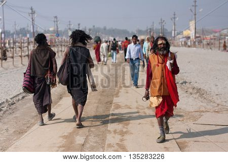 ALLAHABAD, INDIA - JAN 27, 2013: Indian worshipers rushing to Sangam during the biggest festival in the world - Kumbh Mela on January 27, 2013 in Allahabad. Maha Kumbh Mela is held every 12 years here
