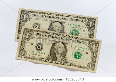 US currency two one dollar bank notes on white background