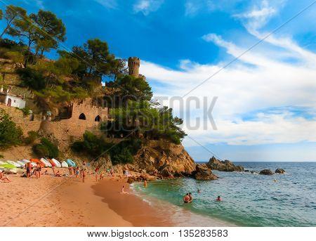 LLORET DE MAR SPAIN - SEPTEMBER 14, 2015: Castell Plaja at Sa Caleta and beach in costa Brava of Catalonia Spain