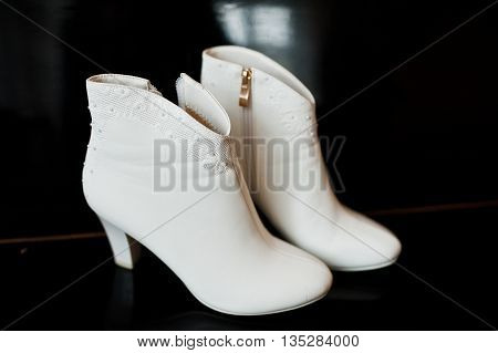 White Bridal Boots Shoes At Black Bacground