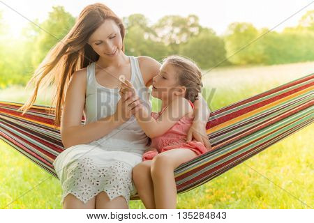 mother playing with daughter hammock