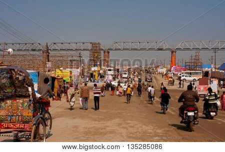 ALLAHABAD, INDIA - JANUARY 29, 2013: People and traffic on biggest festival in the world - Kumbh Mela on January 29, 2013. Kumbh Mela 2013 will take 130 000 000 visitors during 55 days.