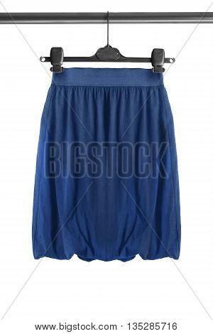 Blue skirt on clothes rack isolated over white
