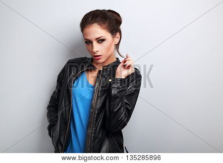 Sexy Young Woman Posing In Fashion Black Leather Jacket On Blue Background With Empty Space