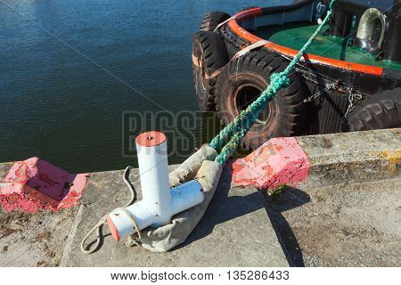 Mooring Bollard With Green Naval Rope