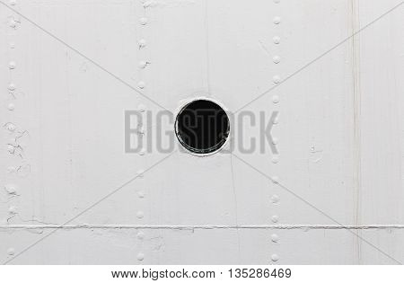 Small Round Rusted Porthole In White Ship Hull