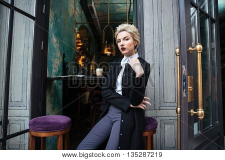 Portrait of a stylish young woman blogger looking at camera