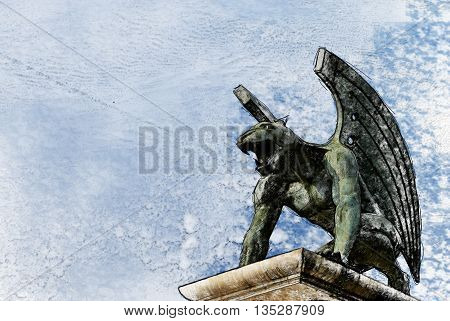 guardian gargoyle over Pont del Regne of bridge of the kingdom. Valencia. Spain