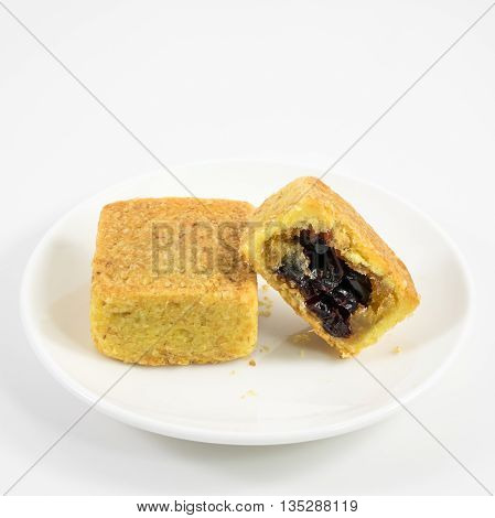 The tasty Taiwanese cranberry pastry cake on the small white dish.