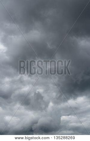 Clouds over horizon storm rain. Cloudy sky background.