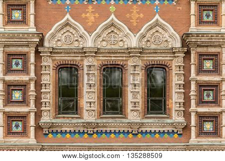 Several windows in a row on facade of the Church of the Savior on Spilled Blood front view St. Petersburg Russia
