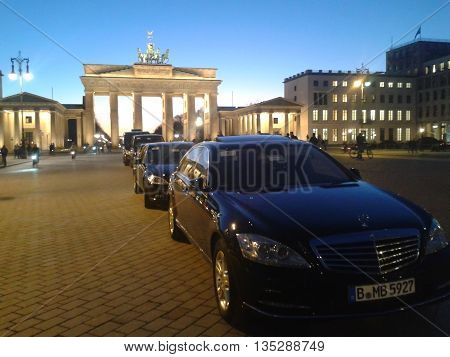BERLIN GERMANY - 11 MARCH 2013: The best german automobile Mercedes parked in the centre of capital Germany Berlin. Brandenburg gate at night.